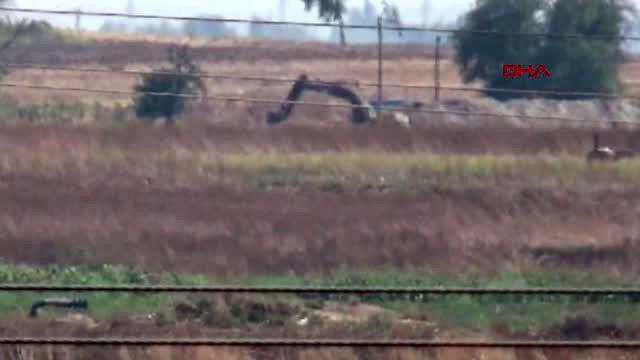 Ortak devriyedeki helikopterleri gören teröristler, kazıyı bıraktı